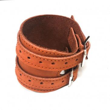 Håndledsbeskyttelse i blød læder og med bæltespænder